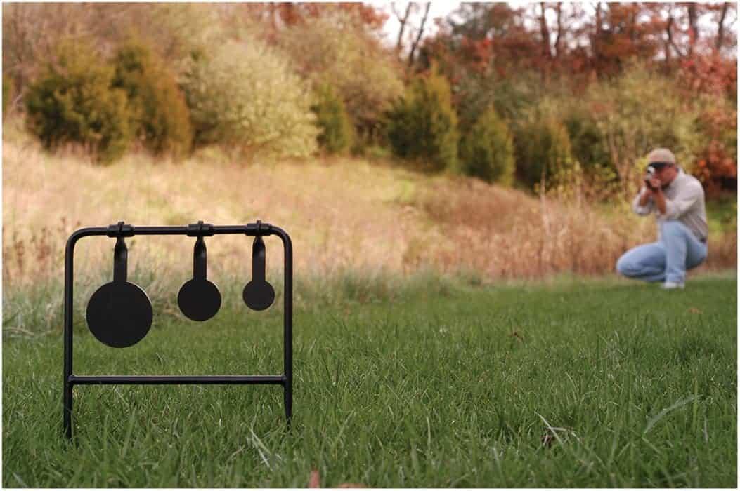 Caldwell® Plink N' Swing™ .22 Rimfire Triple Spin Target - 147072 action 1
