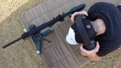 The Rock™ Shooting Rest and Rear Bag Combo - 383640 Range Action Putting Muffs On 250x141