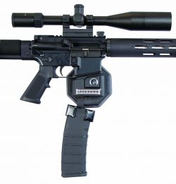 AR-15 Mag Well Lock with Wall Mount - mag locked on AR 250x261